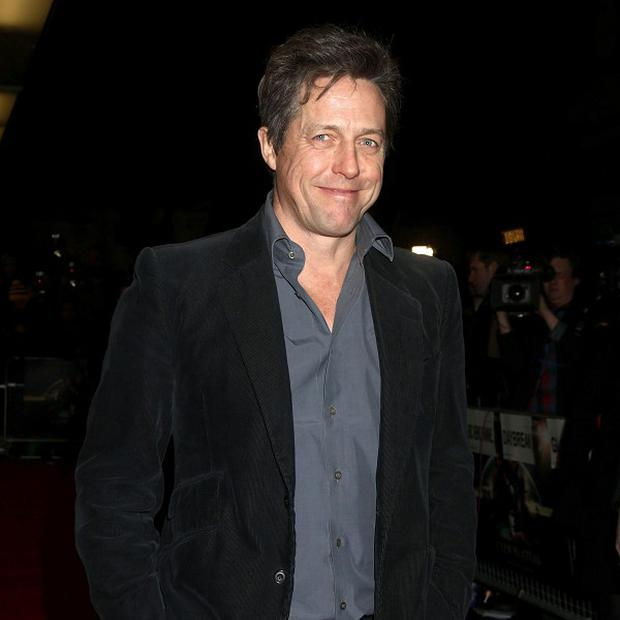 Hugh Grant arriving at the gala screening of Cloud Atlas