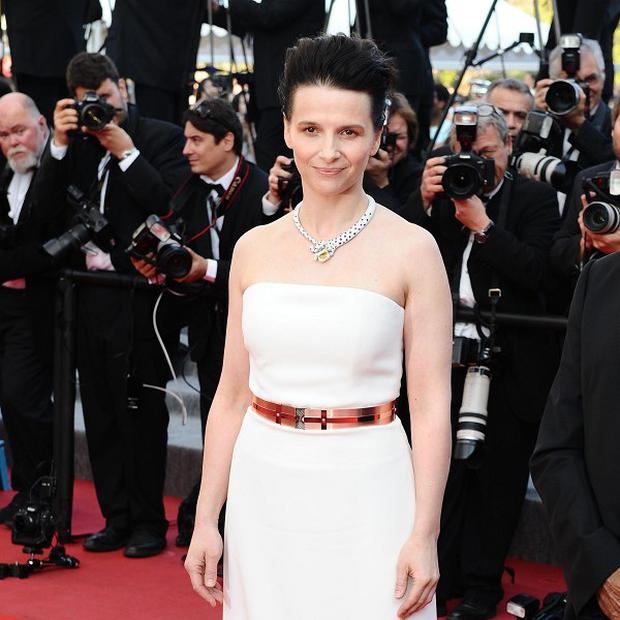 Juliette Binoche is discussing a role in Godzilla