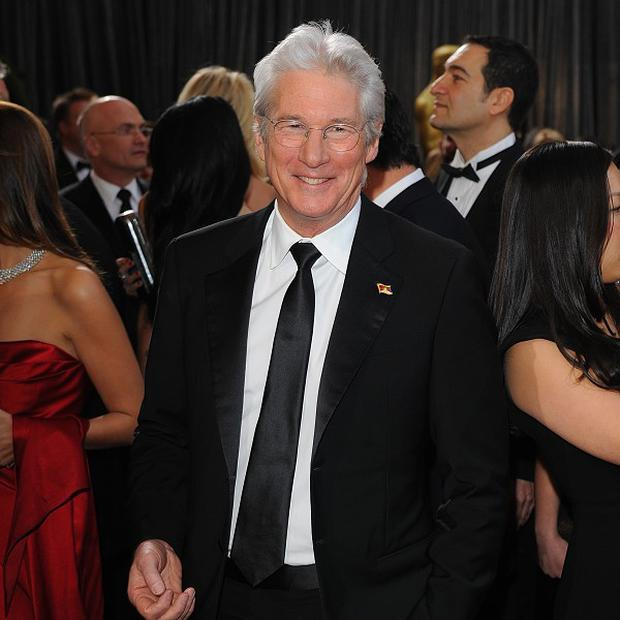Richard Gere arriving for the 85th Academy Awards at the Dolby Theatre, Los Angeles. PRESS ASSOCIATION Photo. Picture date: Sunday February 24, 2013. See PA story SHOWBIZ Oscars. Photo credit should read: Ian West/PA Wire