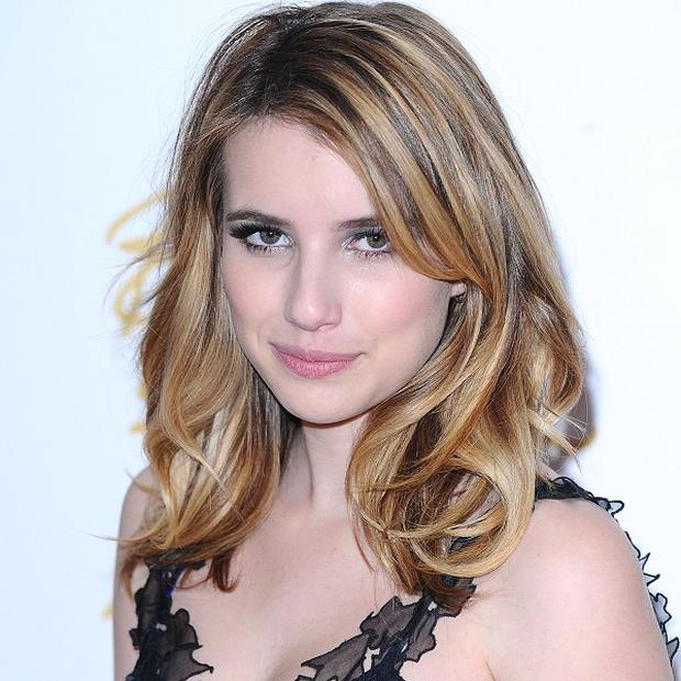 Emma Roberts stars with John Cusack in Adult World
