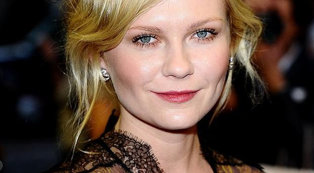 Kirsten Dunst said kissing Brad Pitt wasn't much fun for a 12-year-old girl
