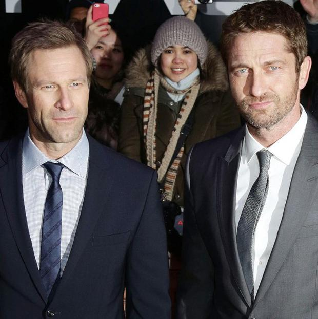 Gerard Butler (right) and Aaron Eckhart at the European premiere of Olympus Has Fallen at the BFI Imax on London's South Bank