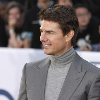 Tom Cruise arrives at the LA premiere of Oblivion