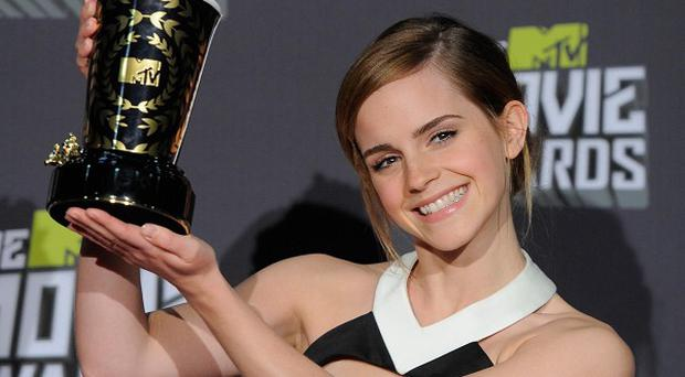Emma Watson poses with the Trailblazer award backstage at the MTV Movie Awards (Chris Pizzello/Invision /AP)