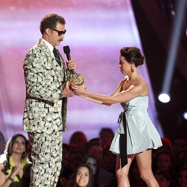 Aubrey Plaza tries to take away an award presented to Will Ferrell during the MTV Movie Awards (AP)