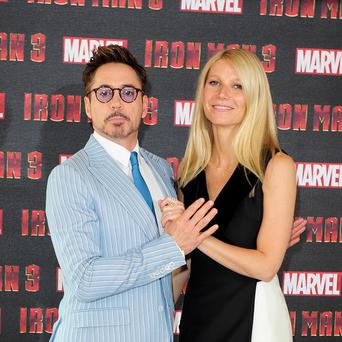 Robert Downey Jr and Gwyneth Paltrow at a photocall for new film Iron Man 3