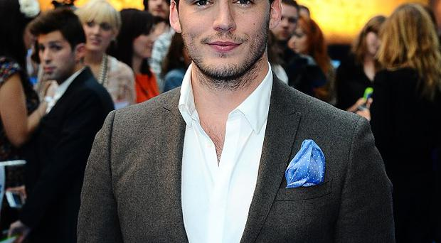 Sam Claflin broke his hand filming action scenes for Catching Fire