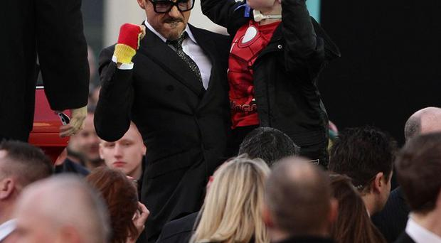 Robert Downey Jr with a young boy at the premiere of Iron Man 3 at the Odeon Leicester Square, London