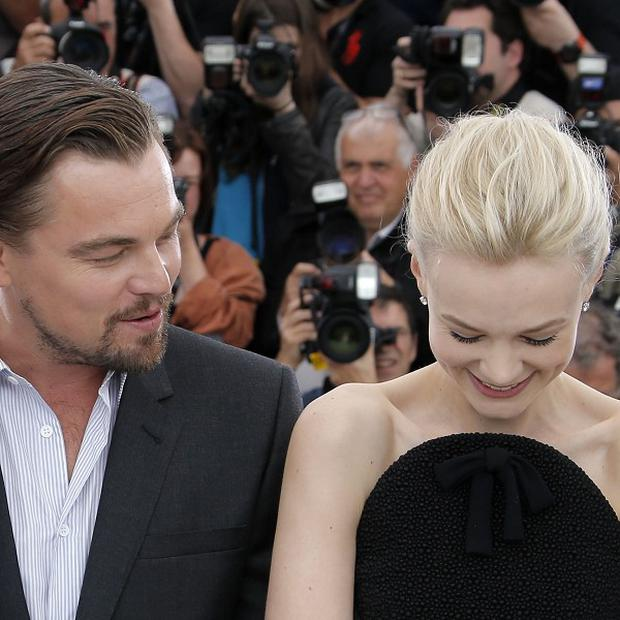Leonardo DiCaprio and Carey Mulligan pose for photographers in Cannes