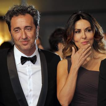 Director Paolo Sorrentino, left, and actress Sabrina Ferilli arrive for the screening of The Great Beauty at the Cannes film festival (AP)