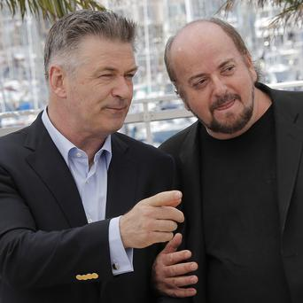 Alec Baldwin speaks with director James Toback during a photo call for the film Seduced and Abandoned (AP/Lionel Cironneau)