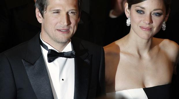 Director Guillaume Canet and actress Marion Cotillard in Cannes