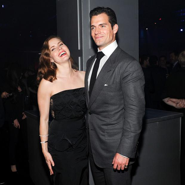Amy Adams and Henry Cavill share a joke on the red carpet at the Man Of Steel world premiere
