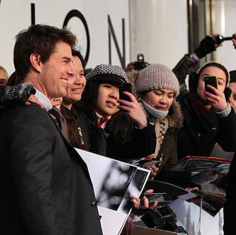 Tom Cruise takes time to greet fans on a promotional tour for his latest film Oblivion