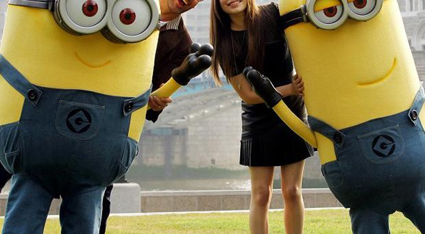 Steve Carell, Miranda Cosgrove and the Minions pose to promote Despicable Me 2