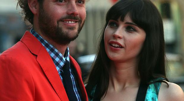 Director Drake Doremus and Felicity Jones arrive for the screening of Breathe In