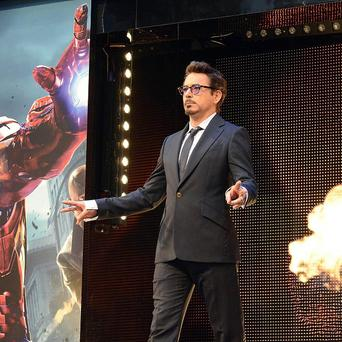 Robert Downey Jr is to reprise his role as Iron Man in two more Avengers movies