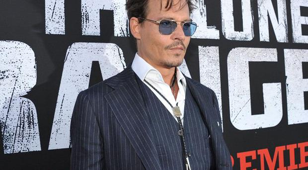 Johnny Depp would be happy to make another Lone Ranger movie