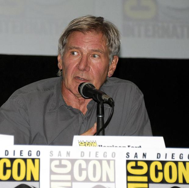 Harrison Ford answers a question at the 2013 Comic-Con International Convention in San Diego (Denis Poroy/Invision/AP)