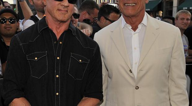 Sylvester Stallone and Arnold Schwarzenegger arrive at the Escape Plan special screening at Comic-Con International (AP)