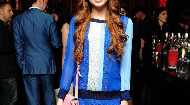 Karen Gillan shocked fans at Comic-Con when she removed her red tresses to reveal a bald head