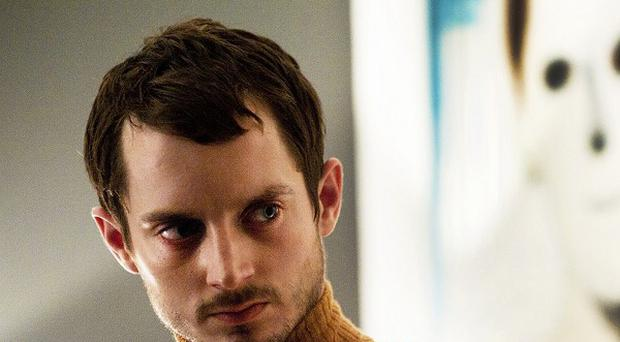 Elijah Wood plays a scalp-collecting serial killer in Maniac
