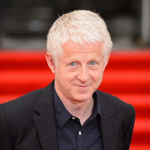 Director Richard Curtis arriving at the premiere of About Time at Somerset House in central London