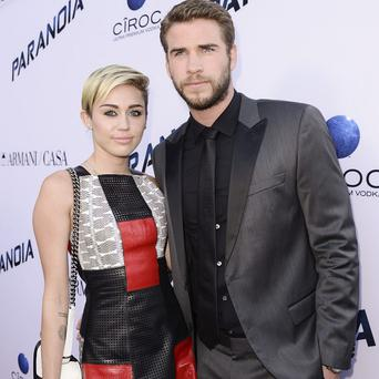 Liam Hemsworth and Miley Cyrus stepped out for the premiere of Paranoia in LA