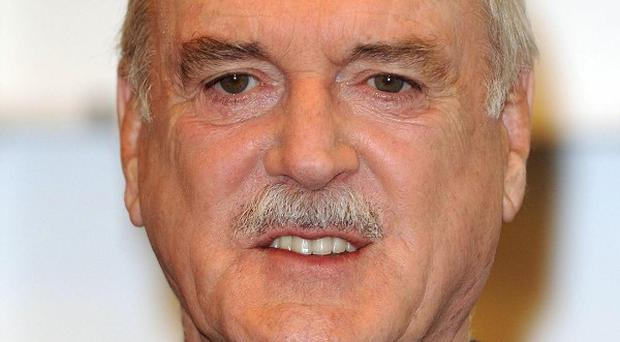 John Cleese says a Monty Python reunion is 'too difficult geographically'