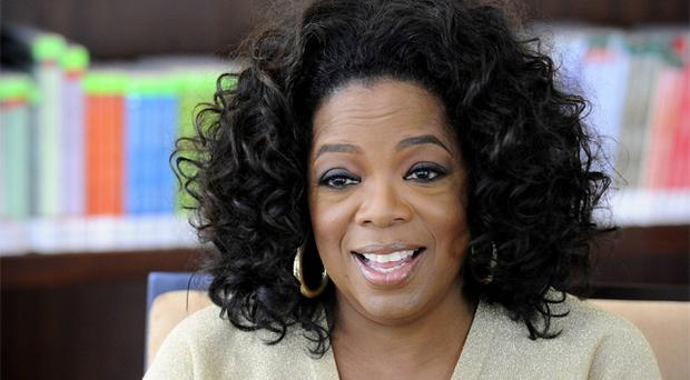 Oprah Winfrey says she was a victim of racism during a recent visit to Switzerland