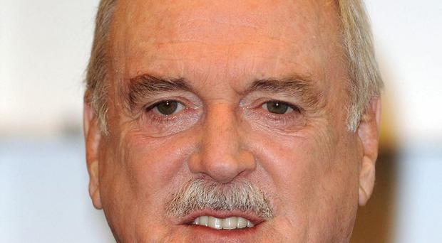 John Cleese claims he is a terrible singer