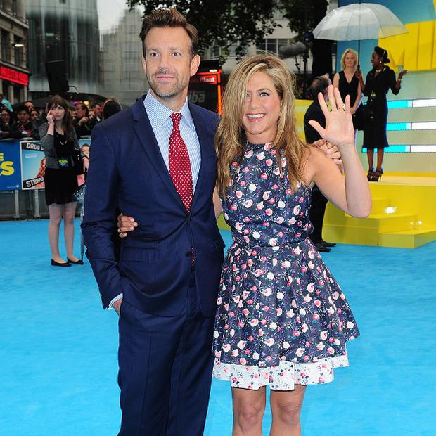 Jason Sudeikis and Jennifer Aniston arrive at the European film premiere of We're The Millers, at Leicester Square, London