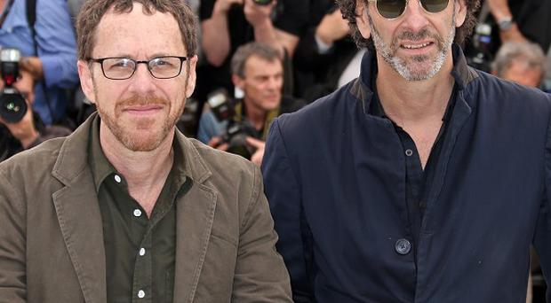 Ethan Coen, left, and Joel Coen will celebrate the folk music of their drama Inside Llewyn Davis with a concert in New York (Joel Ryan/Invision/AP)