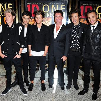 Simon Cowell with One Direction arriving for the World Premiere of One Direction: This Is Us