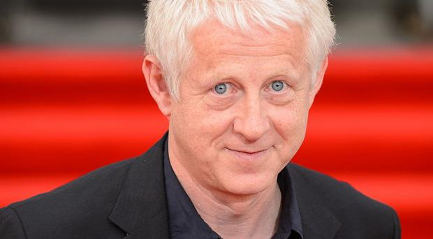 Richard Curtis doubts there will be a Blackadder film