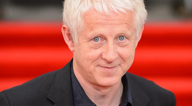 Richard Curtis said his time-travelling wishlist would include music legends