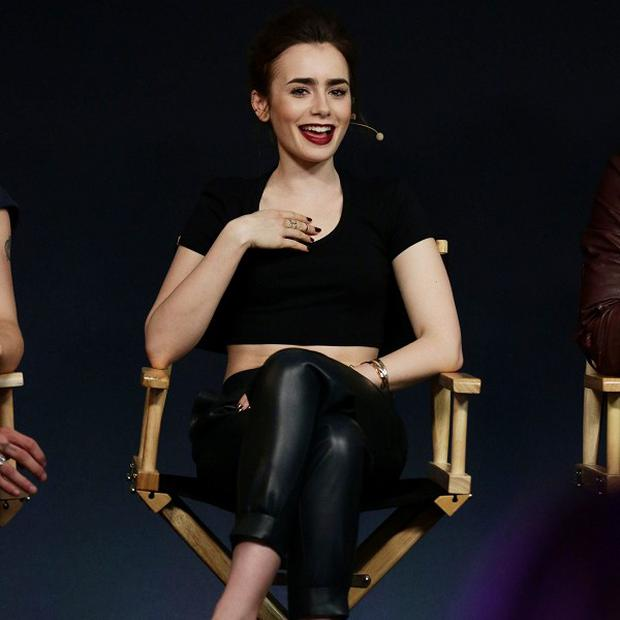 Lily Collins stars in The Mortal Instruments: City of Bones - the sequel to the film has been delayed