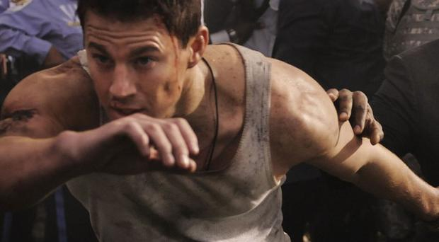 Channing Tatum strips down to his vest in White House Down