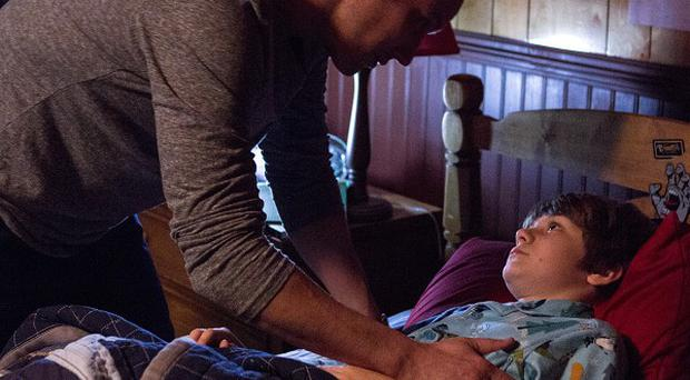 Patrick Wilson and Ty Simpkins in a scene from Insidious: Chapter 2