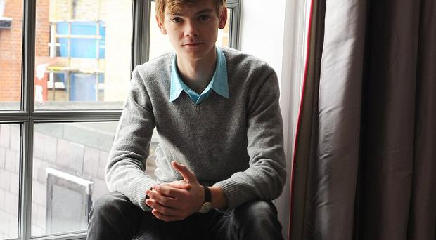 Thomas Sangster would like a darker role