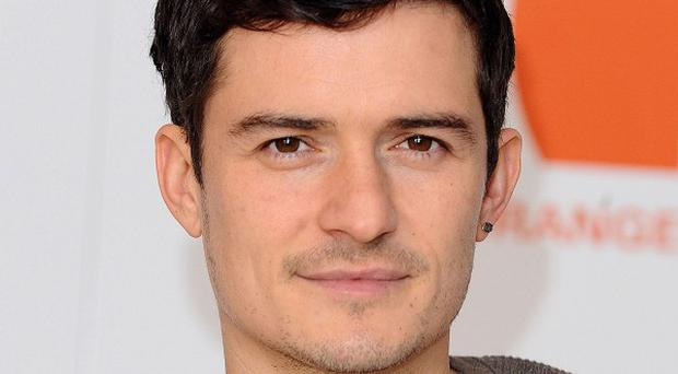 Orlando Bloom thinks his son will love his films