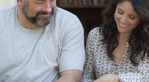 Julia Louis-Dreyfus and James Gandolfini in a scene from Enough Said