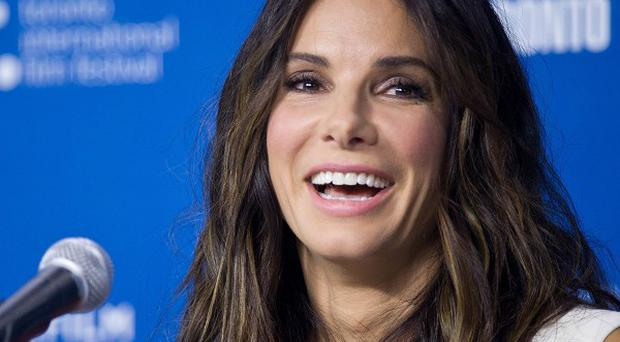 Sandra Bullock has to plan her film roles around her young son