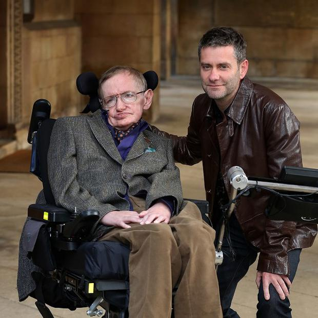 Professor Stephen Hawking and director Stephen Finnigan arrive for a screening of Hawking