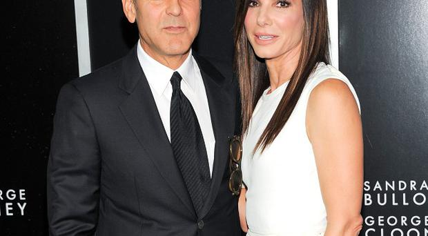 George Clooney and Sandra Bullock attending the New York premiere of new film Gravity