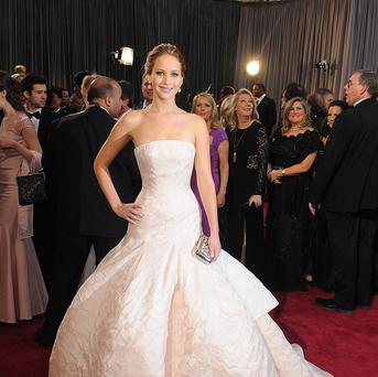 Jennifer Lawrence in her full length gown at the Academy Awards