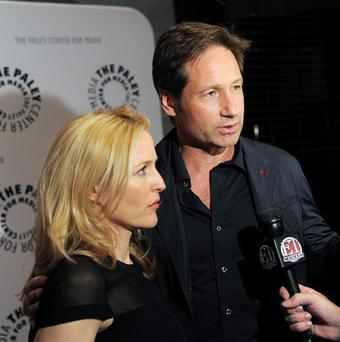 Gillian Anderson and David Duchovny are willing to make a third X-Files movie (Evan Agostini/Invision/AP)