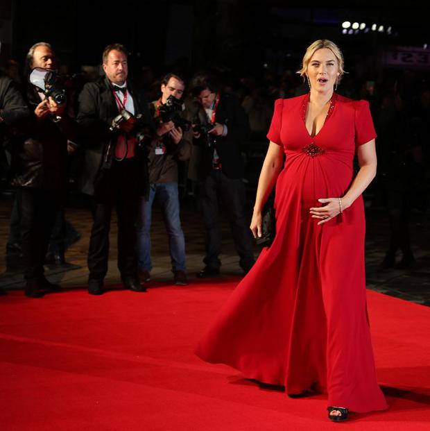 Kate Winslet arrives on the red carpet for the gala screening of the film Labor Day