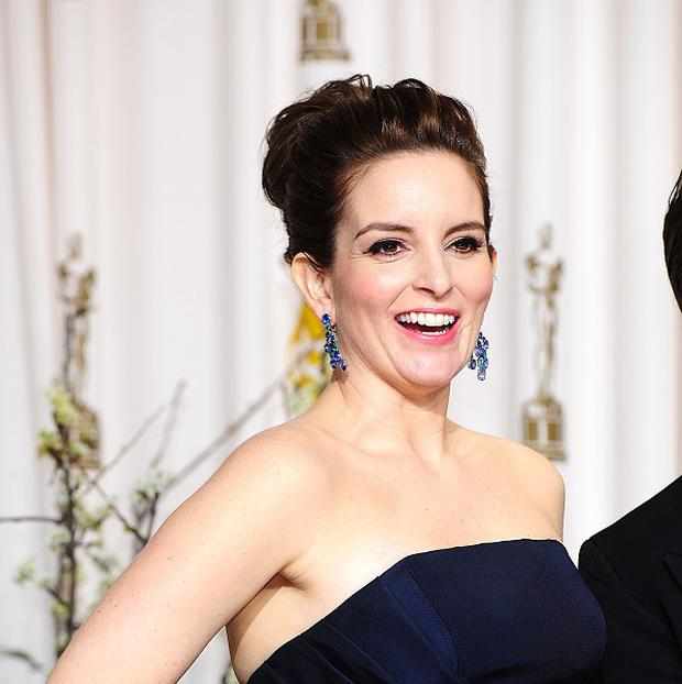 Tina Fey will host the Golden Globes for two more years with Amy Poehler