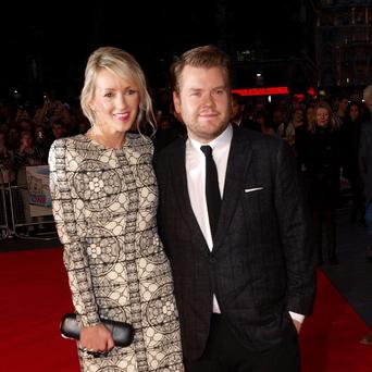 James Corden and his wife Julia Carey arrive at the premiere of One Chance at the Odeon Leicester Square, central London